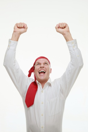 jubilating: Businessman with red tie tied around his head celebrating his success