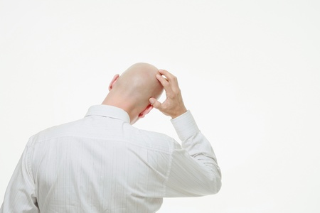 Businessman scratching his head photo