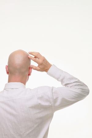 homme chauve: L'homme d'affaires se gratter la t?