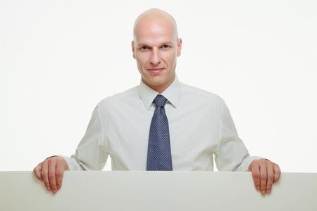 Businessman holding white placard photo