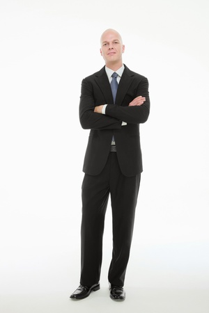 Businessman standing with his arms folded photo