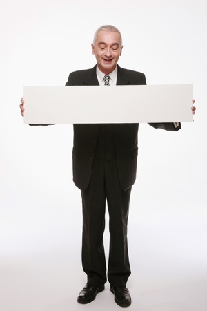 Businessman with white placard photo