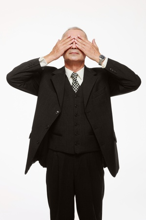 Businessman covering eyes with hands photo