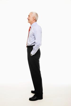 Homme d'affaires debout avec les mains dans les poches Banque d'images