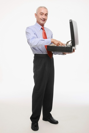Businessman arranging files in his bag photo
