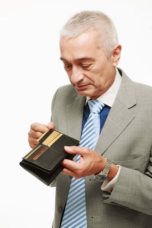 Businessman taking out credit card from his wallet photo