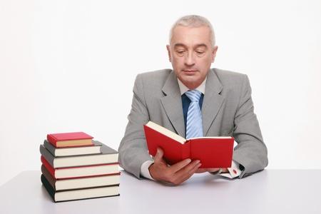 Businessman reading book Stock Photo - 9525983