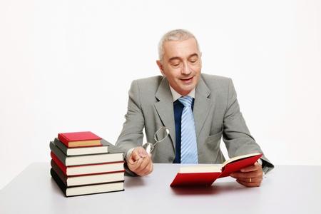 Businessman reading book Stock Photo - 9525907