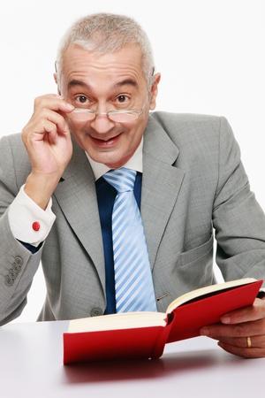 Businessman reading book photo