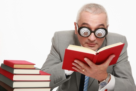 Businessman in funny glasses reading book photo