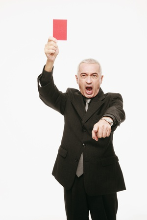 Businessman holding red card and gesturing photo