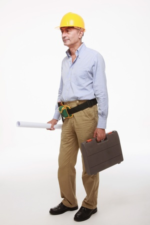 Man holding blue print and tool box photo