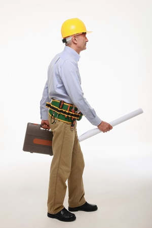 Man holding blue print and tool box Stock Photo - 9525439