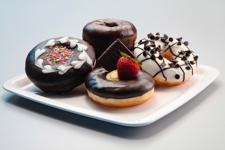 Donuts with icing on a plate photo