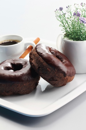 Two donuts and a cup of coffee photo