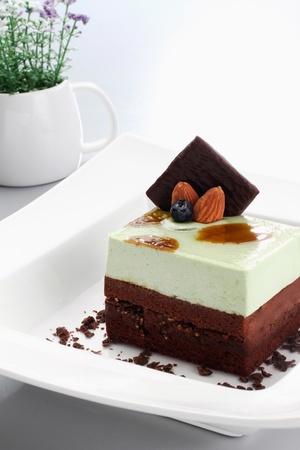 garnishing: Pistachio chocolate cake with fruit garnishing and chocolate flakes
