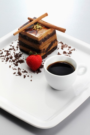 Chocolate coffee layered cake with a cup of coffee photo