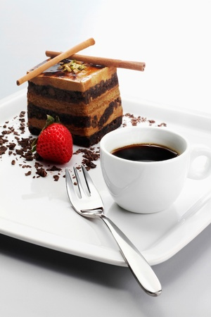 dessert fork: Chocolate coffee layered cake with a cup of coffee
