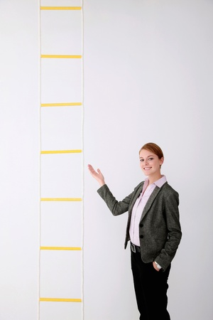 Businesswoman showing rope ladder Stock Photo - 9604529