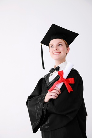 Woman in graduation gown holding scroll