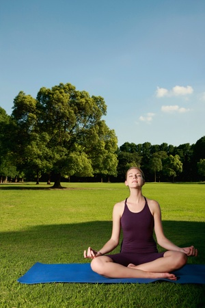 Woman meditating photo