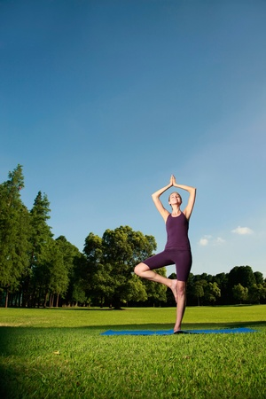 Woman practising yoga photo