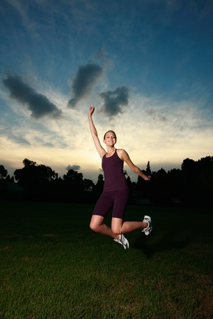 Woman jumping in the park photo