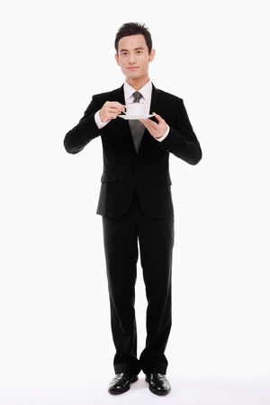 Businessman with a cup of coffee photo