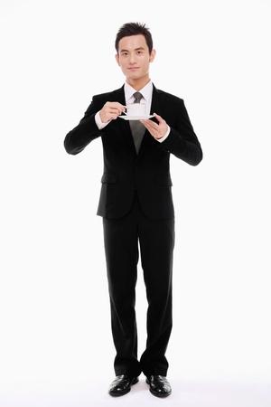 hombre tomando cafe: Hombre de negocios con una taza de café