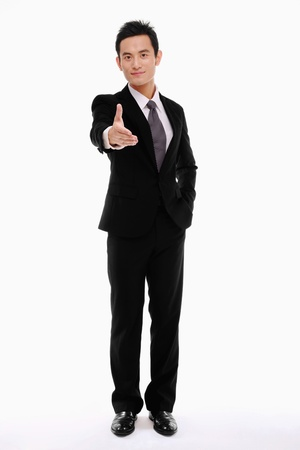 extending: Businessman extending his hand for a handshake Stock Photo