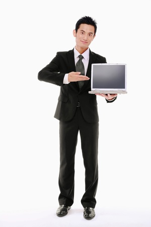 Businessman showing a laptop photo