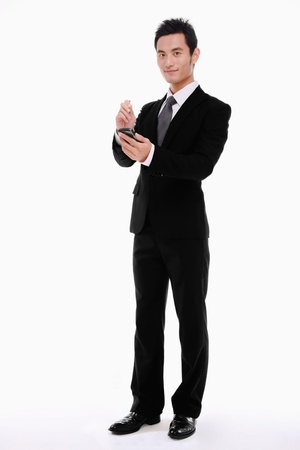 Businessman using electronic organizer photo