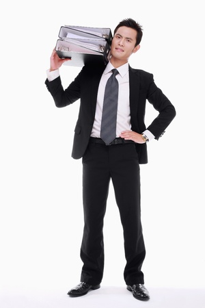 Businessman carrying a stack of files on his shoulder Stock Photo - 9605369
