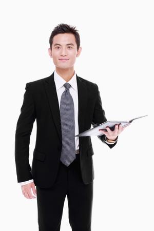 Businessman holding organizer photo