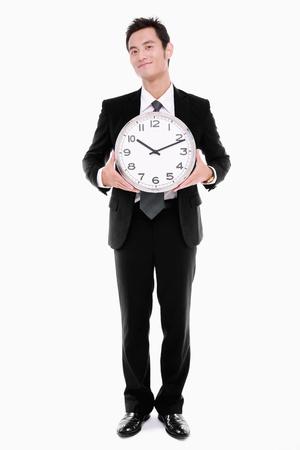 puntualidad: Reloj de explotaci�n del hombre de negocios Foto de archivo
