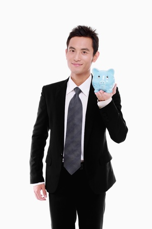 Businessman holding a piggy bank photo