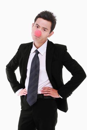 Businessman with red nose standing with arms akimbo photo