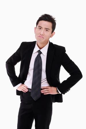 empresario enojado: Empresario enojado con los brazos en posici�n de jarra Foto de archivo