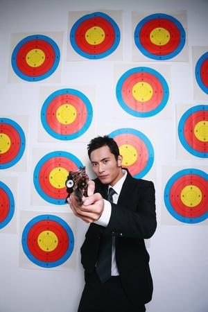 Businessman using gun photo
