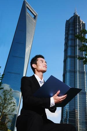 Businessman holding document photo