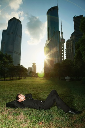 Businessman relaxing in the park photo