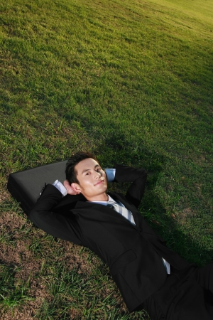 sleeping bag: Businessman relaxing in the park