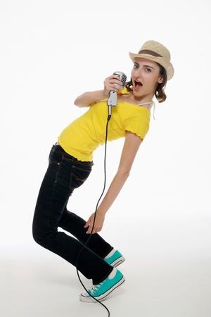 Woman bending backward while singing photo