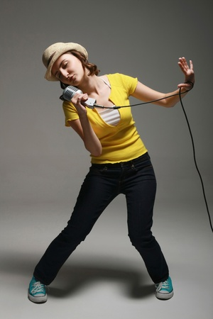 Woman singing and performing photo