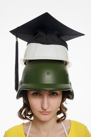 Woman wearing a stack of different hats photo