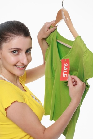 Woman checking out the sale tag on blouse Stock Photo - 9604526
