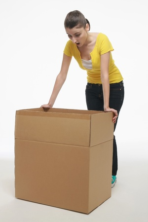 Woman looking shockingly into a cardboard box photo