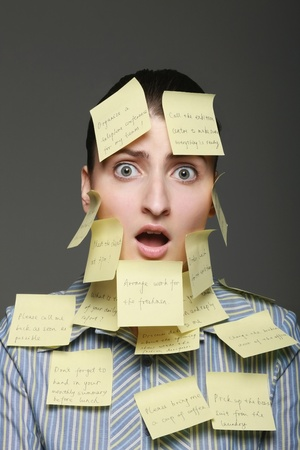 Businesswoman covered with adhesive notes Stock Photo - 9605512