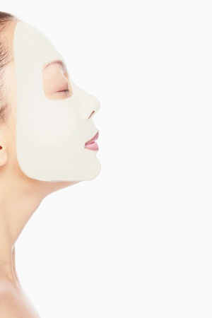 beauty mask: Woman with facial mask