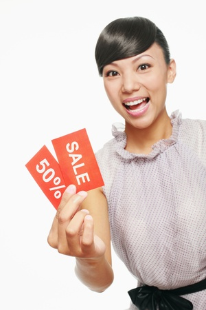 Woman showing sale sign photo